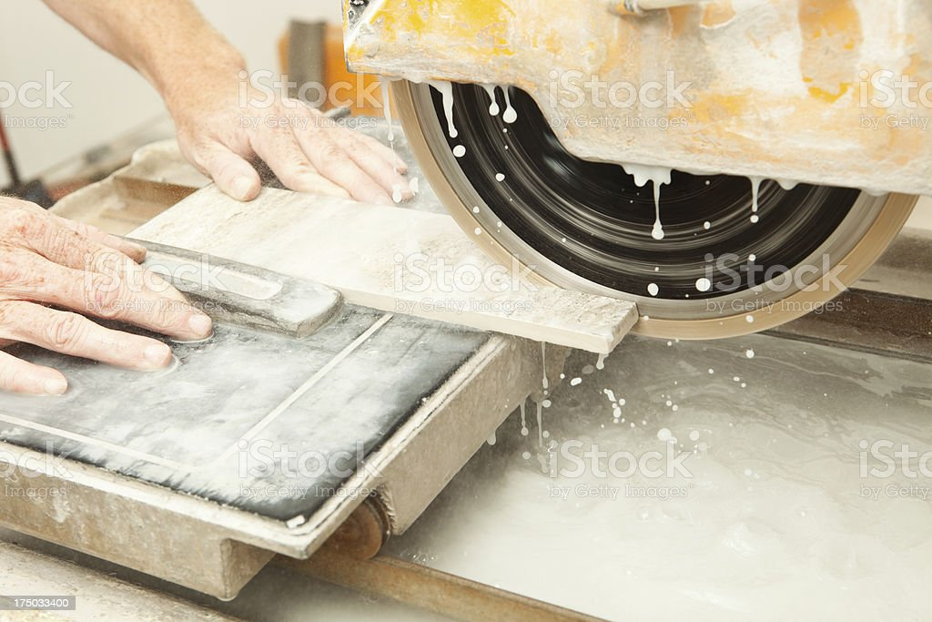 Diamond Blade Wet Saw Cutting Floor Tile stock photo