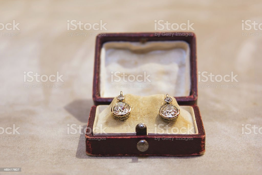 Diamond earring in old box stock photo