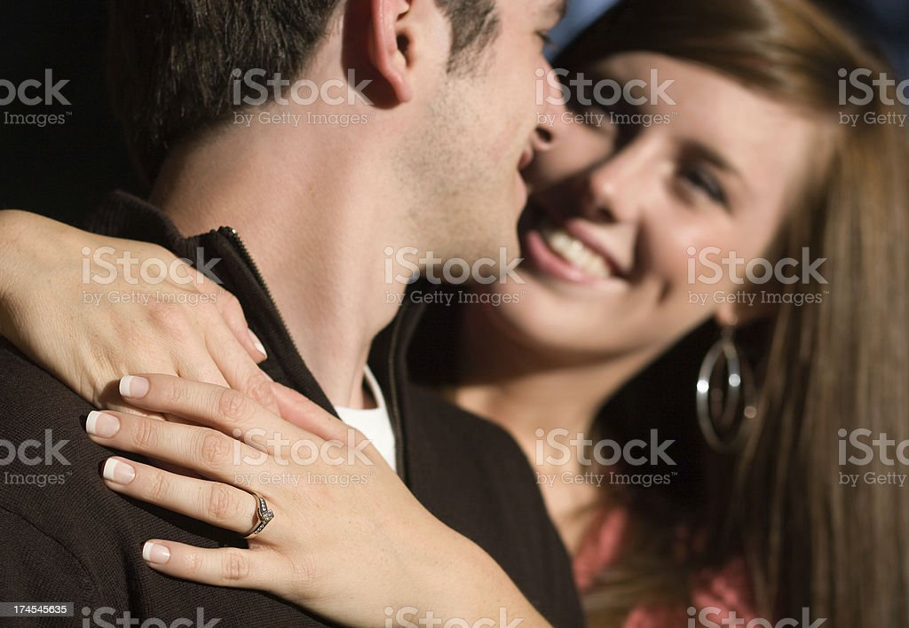 Diamond Engagement Ring on Romantic Young Couple Smiling Outdoors royalty-free stock photo