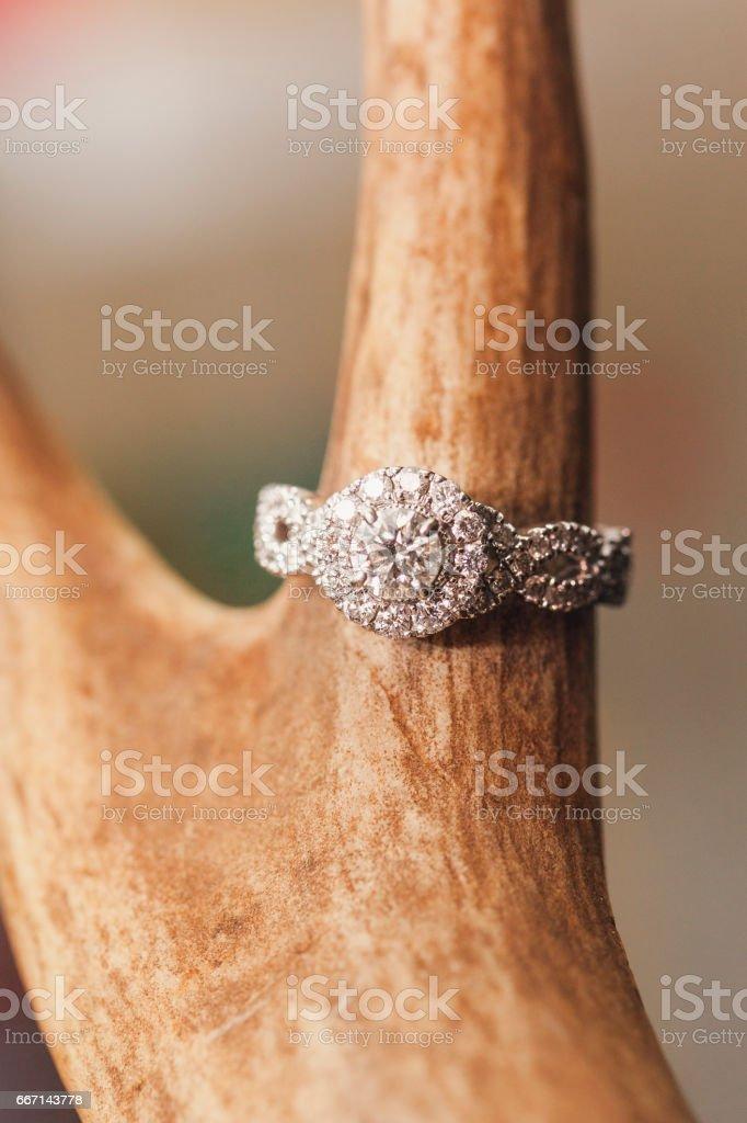 Diamond Engagement Ring on Rustic Antler stock photo
