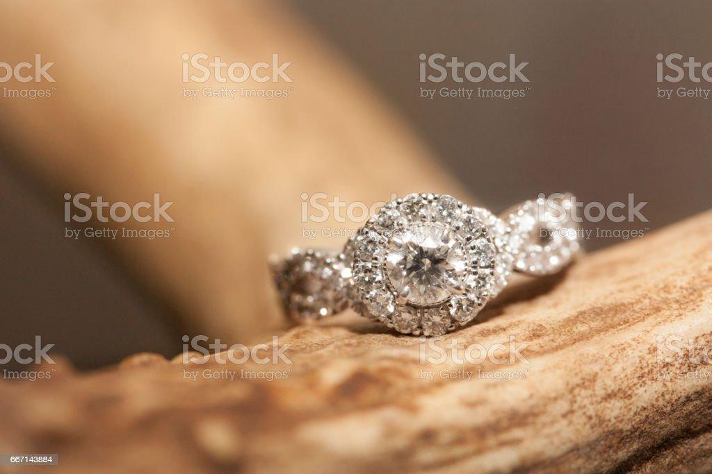 Diamond Engagement Ring on Rustic brown Antler stock photo