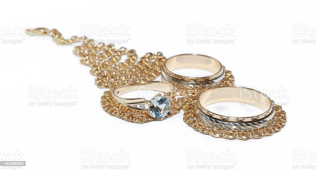 Diamond eye of ring over necklace stock photo