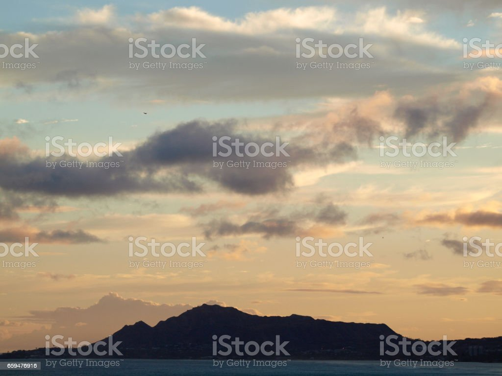 Diamond Head Crater and Kahala Beach with epic dusk scape stock photo