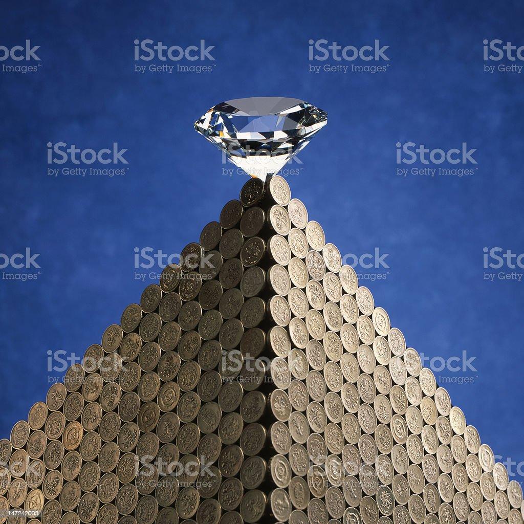 Diamond on coins royalty-free stock photo