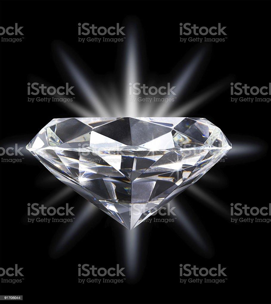 Diamond Over Star Burst Background Isolated on Black royalty-free stock photo