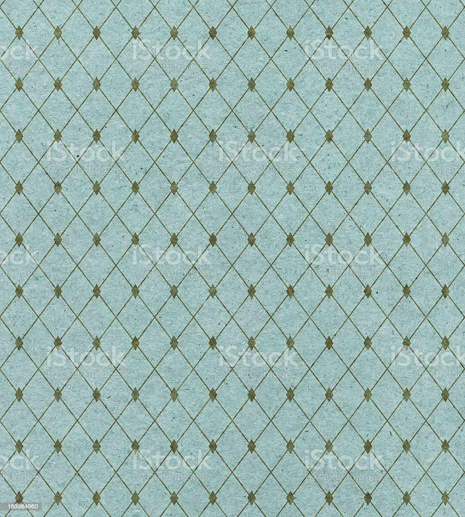 A diamond pattern covers turquoise wallpaper stock photo