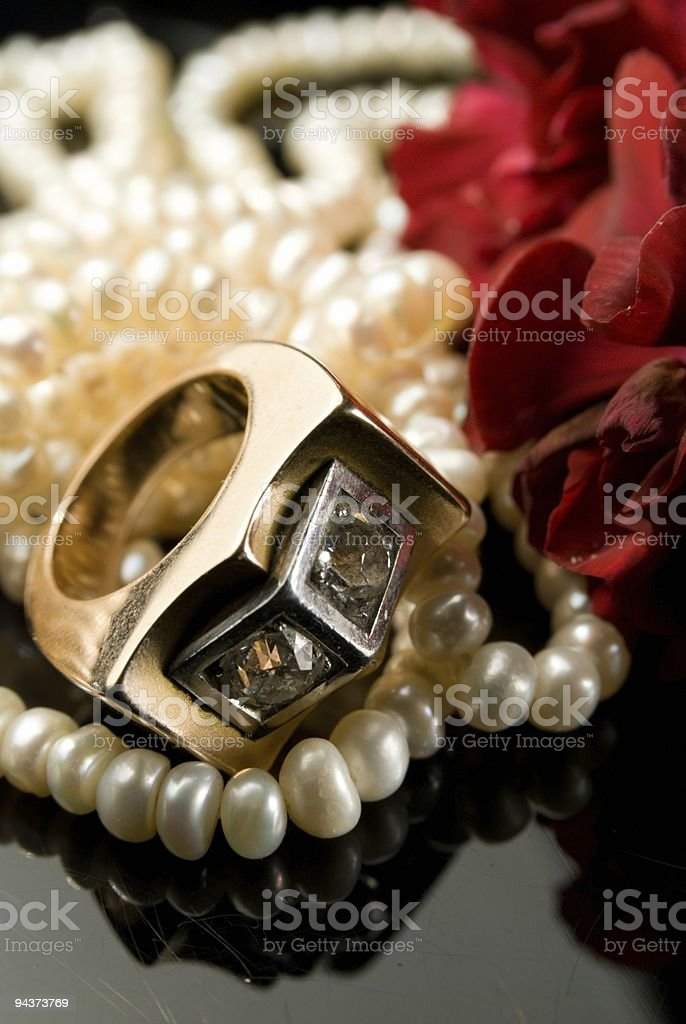 diamond ring and pearl necklace stock photo