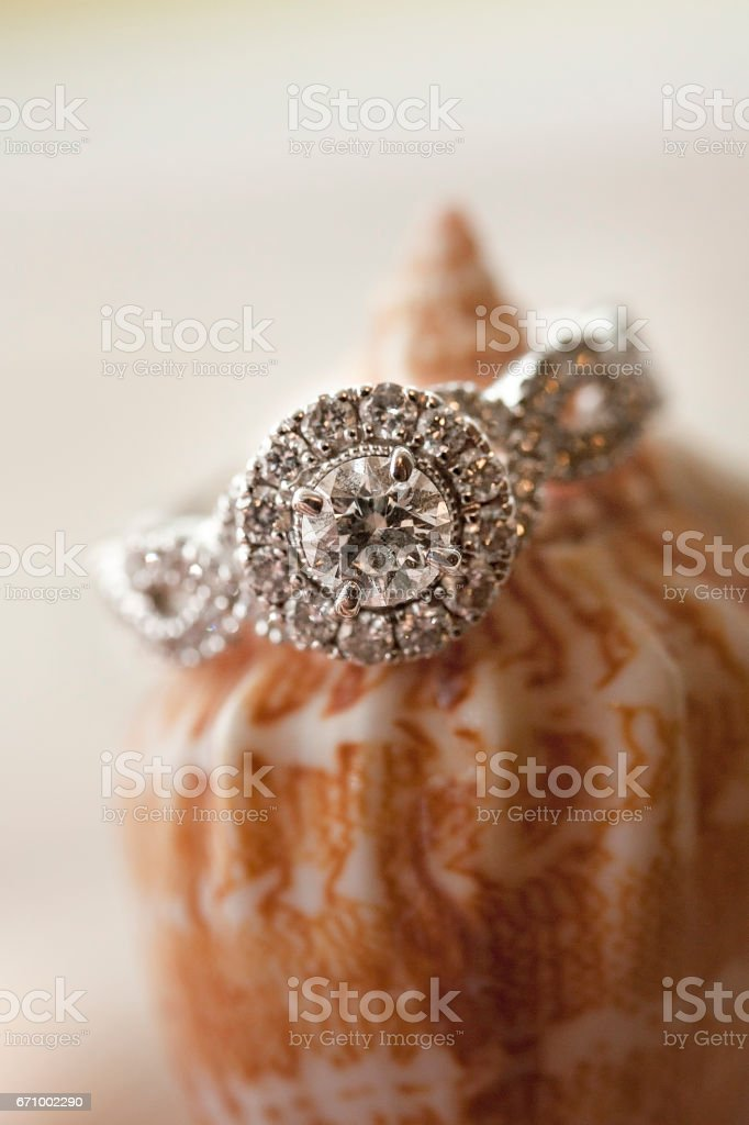 Diamond Ring On Peach-Colored Shell stock photo