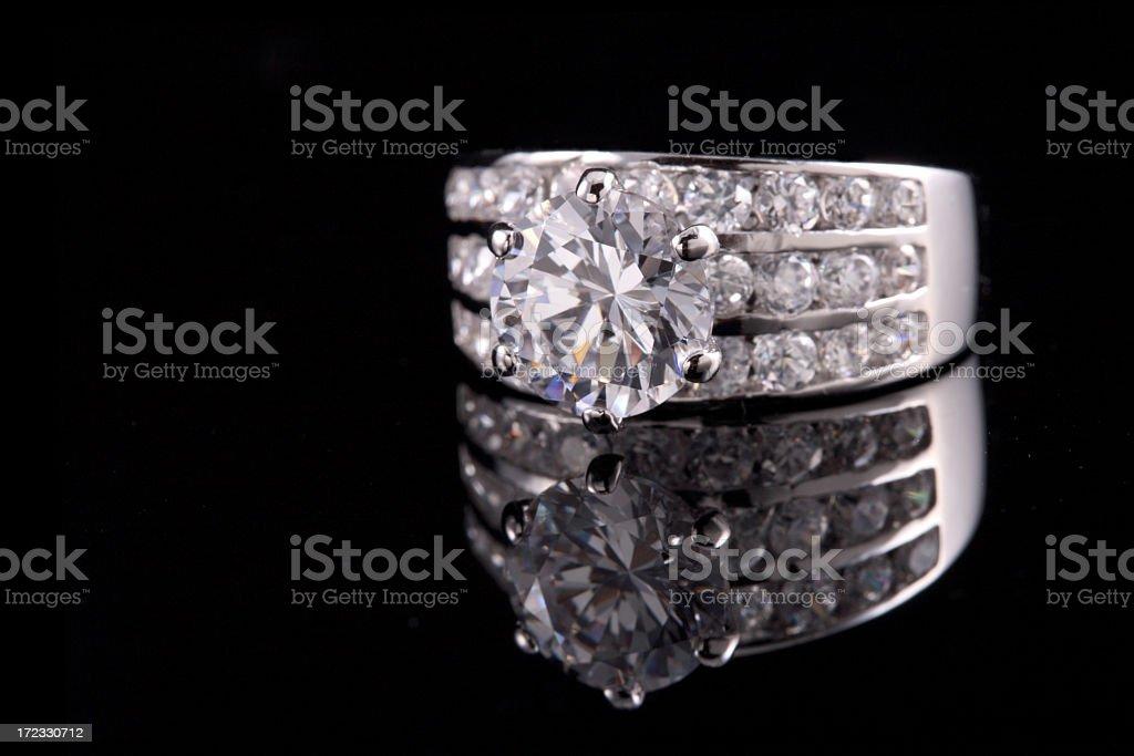 Diamond ring reflected on black background royalty-free stock photo