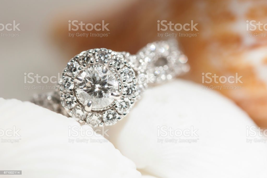 Diamond Ring Resting on Seashells stock photo