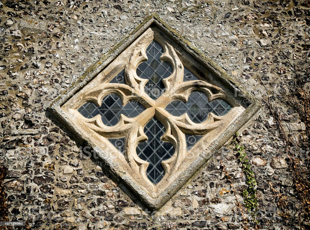 Diamond shaped window in a church stock photo