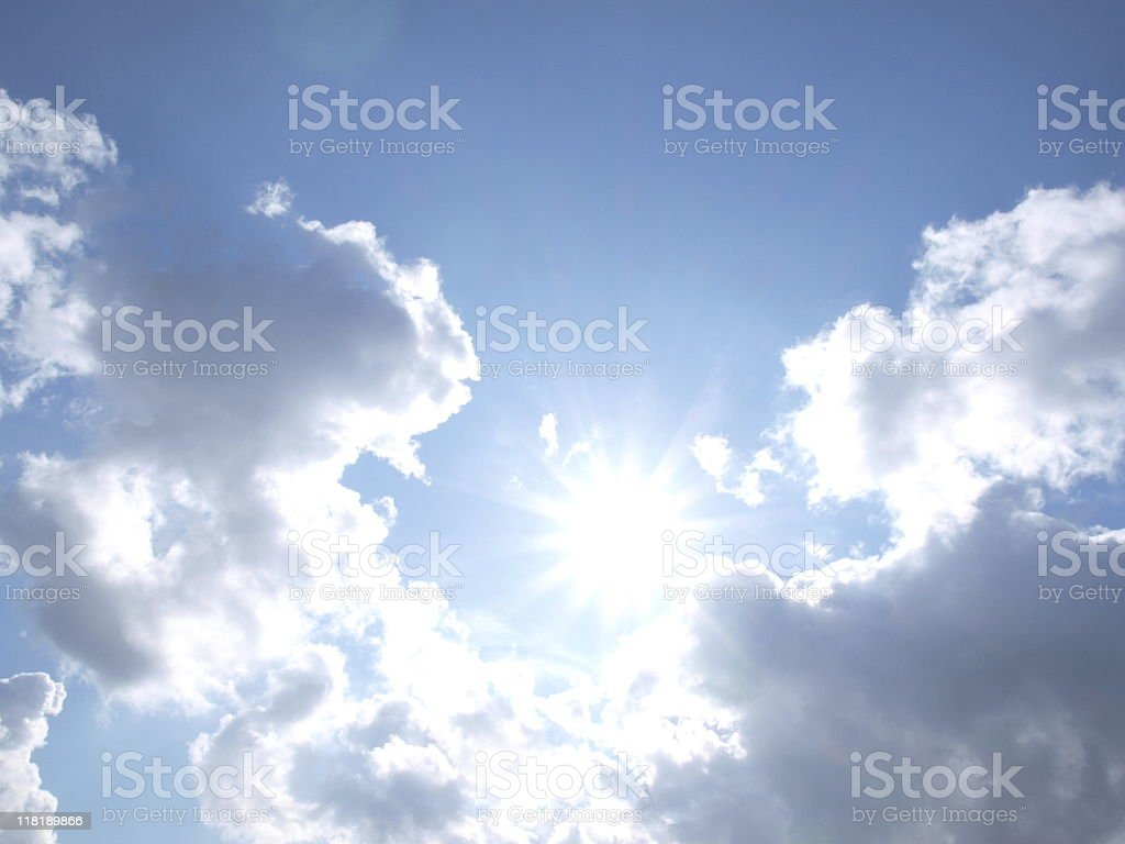Diamond sparkle  sun lights white clouds in blue sky royalty-free stock photo