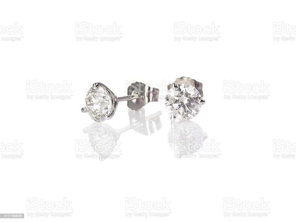 Diamond stud fine jewelry round brilliant pierced earrings stock photo