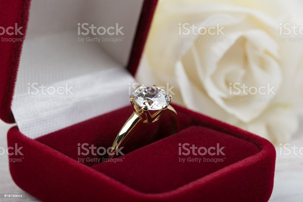 Diamond wedding ring in a red gift box stock photo