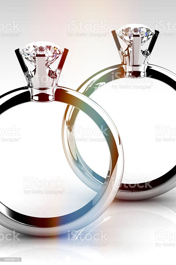 Diamond wedding rings on white background stock photo