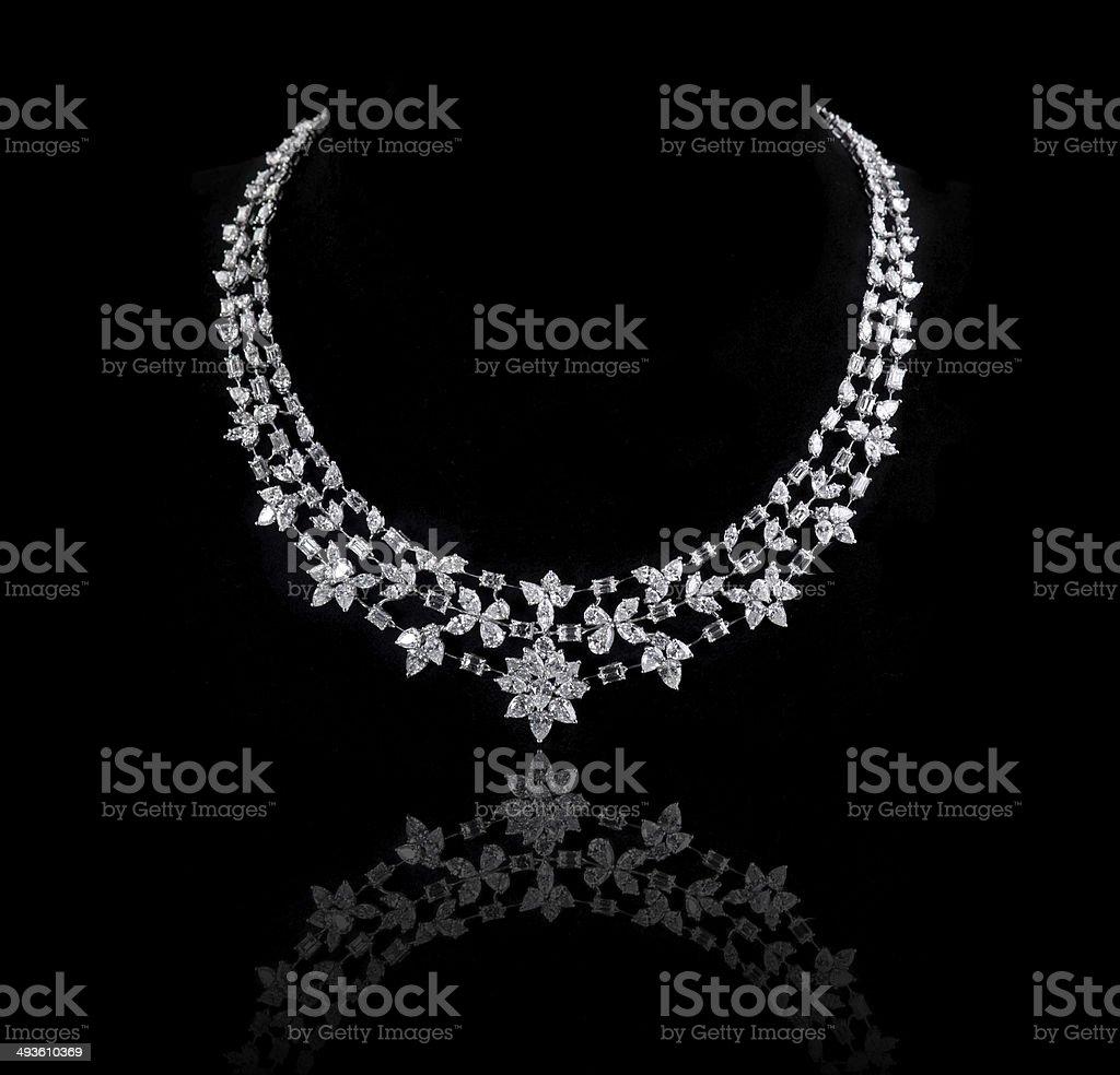 diamonds necklace shot against a black background stock photo