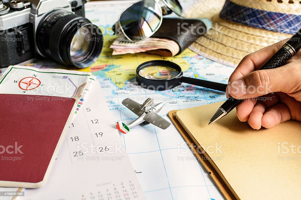 diary and calendar with passport and map stock photo