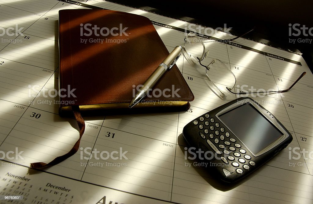 Diary And PDA On A Desk royalty-free stock photo