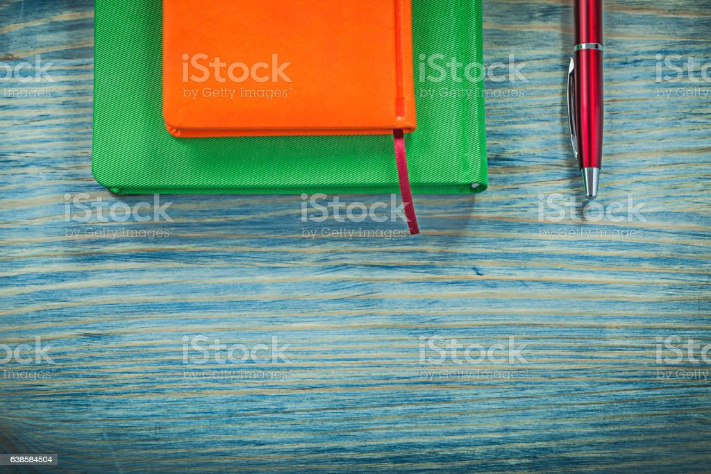 Diary books pen on wood board education concept stock photo