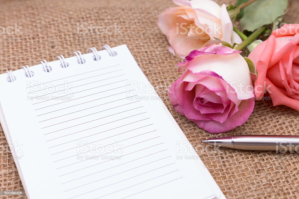 Diary note with rose on gunny bag stock photo