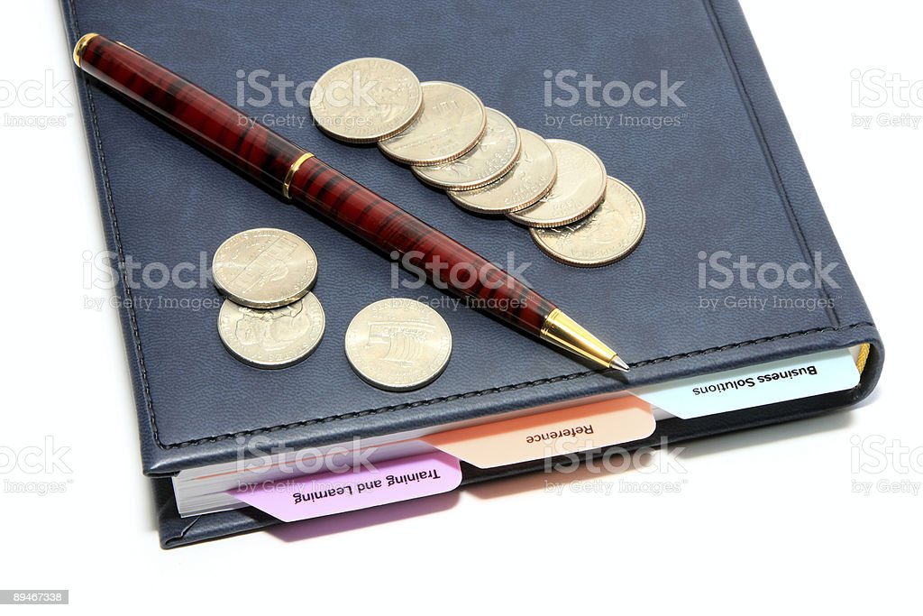 diary, pen and coins on white royalty-free stock photo