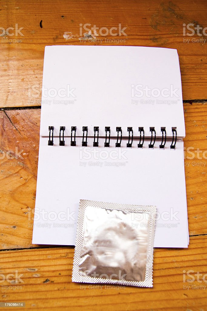 diary with condom and pills royalty-free stock photo