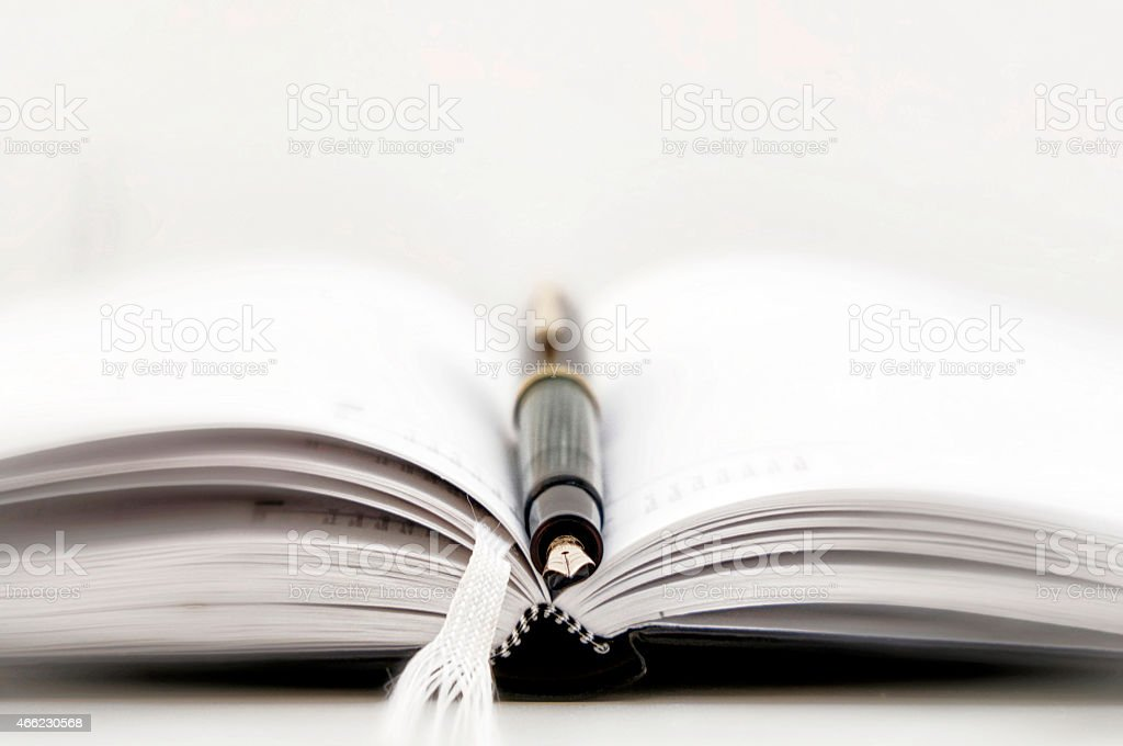 Diary with pen stock photo