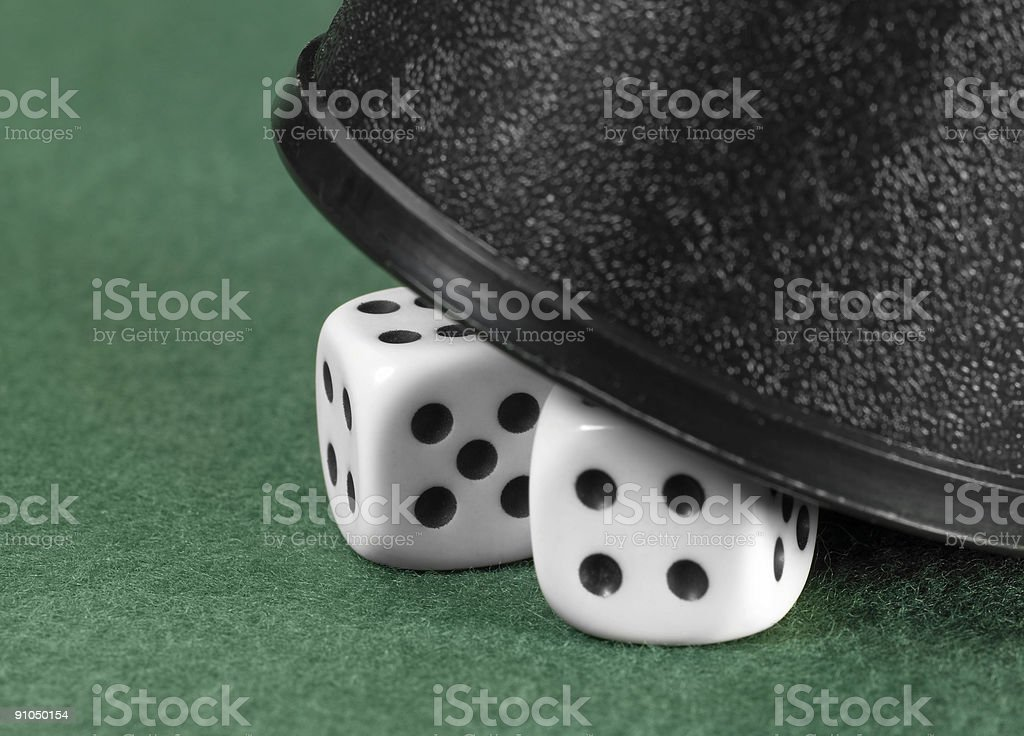 dice and black cup stock photo