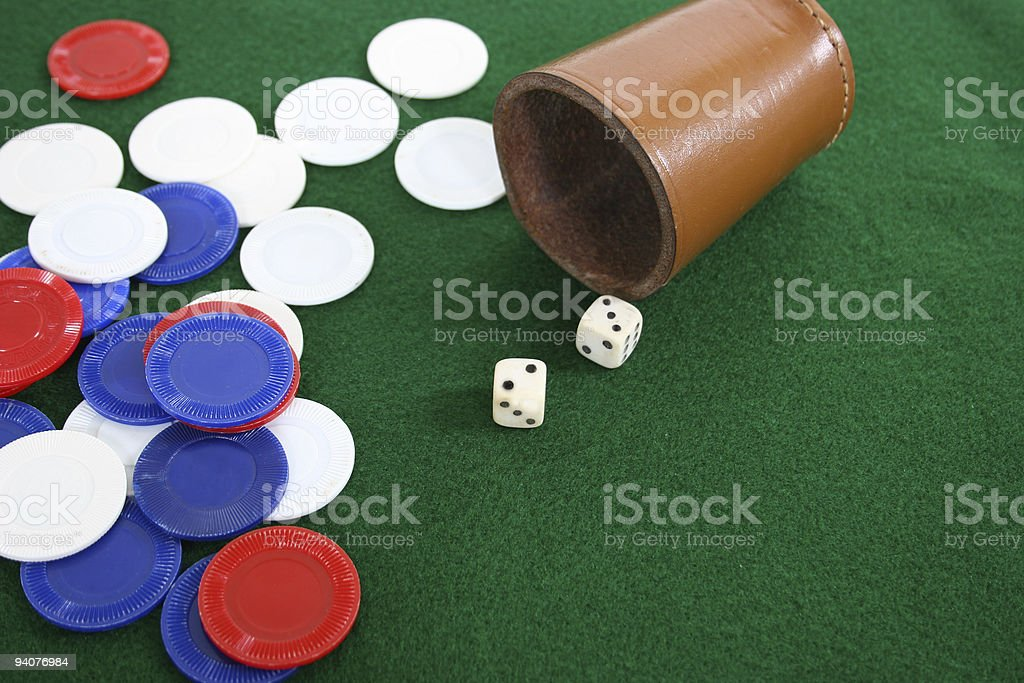 Dice and cup with chips royalty-free stock photo