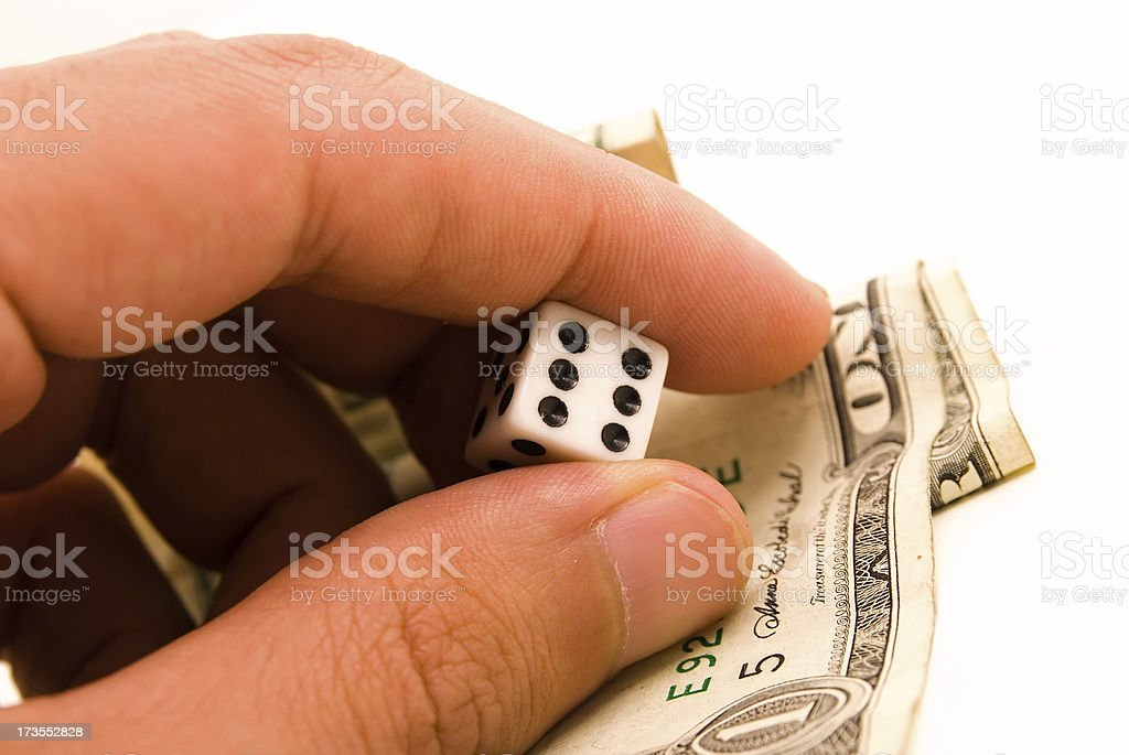 dice and dollars stock photo