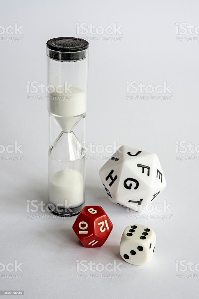 Dice and hourglass stock photo
