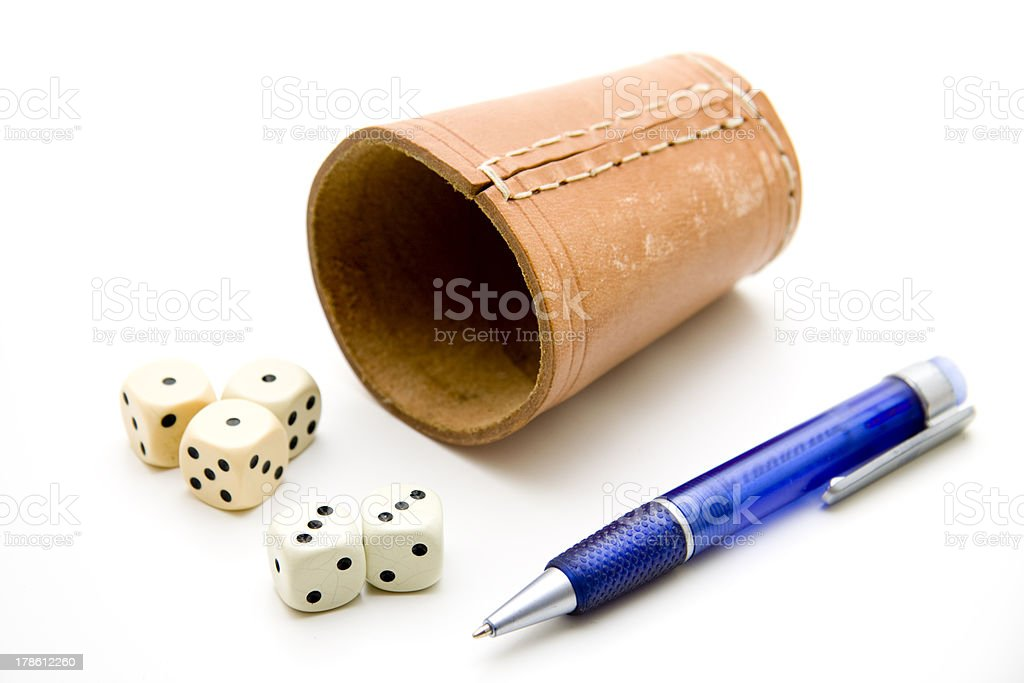 Dice cup with ballpoint pen stock photo