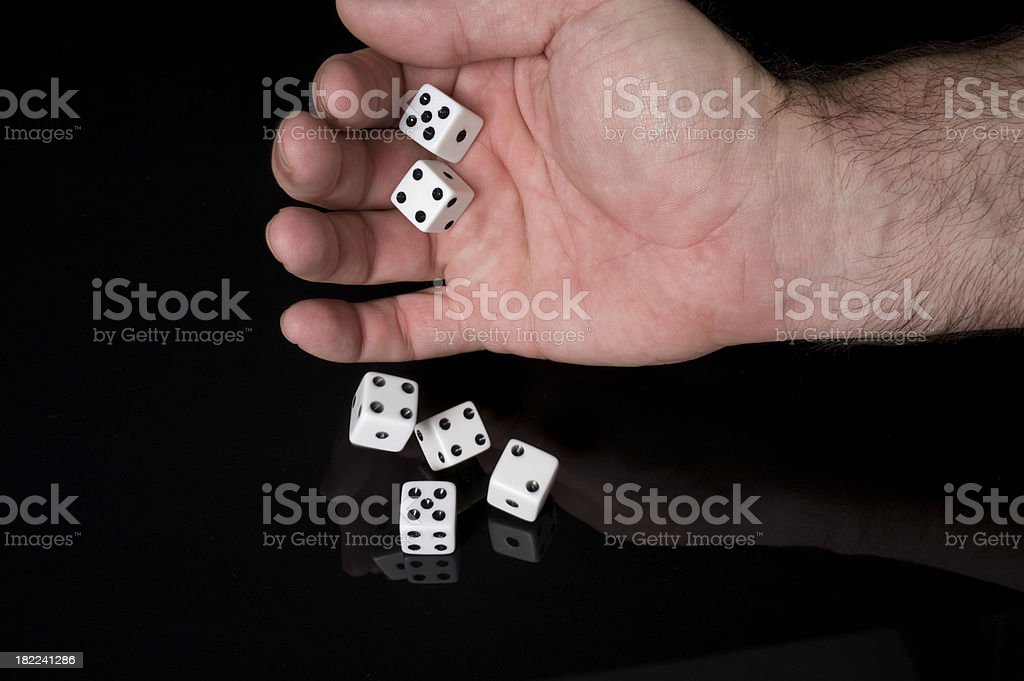 Dice Dropping to a Gloss royalty-free stock photo