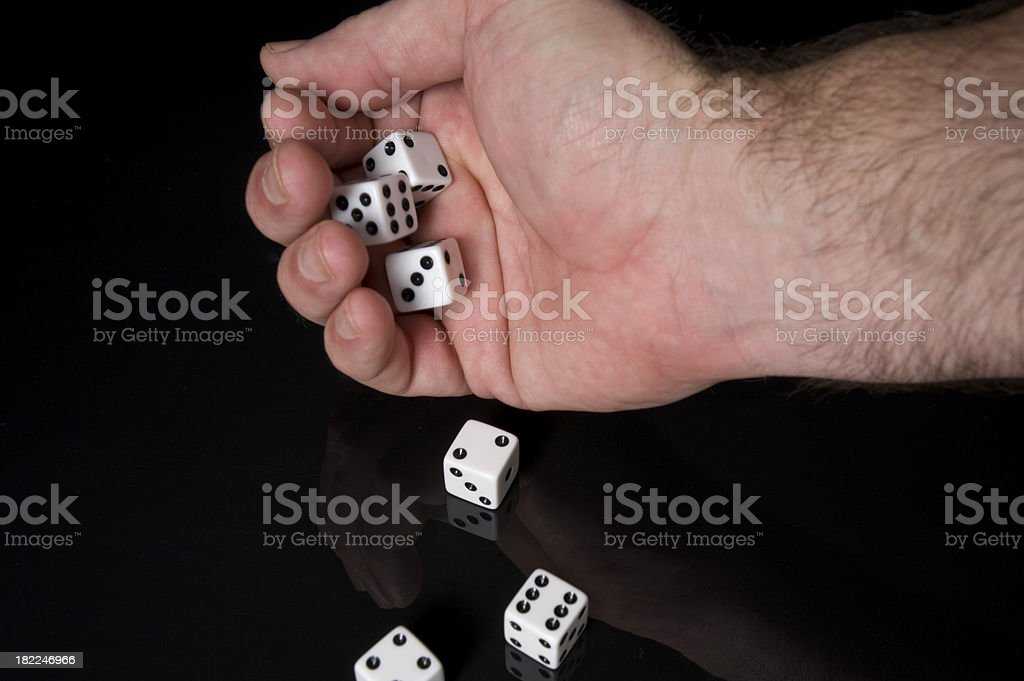Dice Falling Onto Black Surface royalty-free stock photo