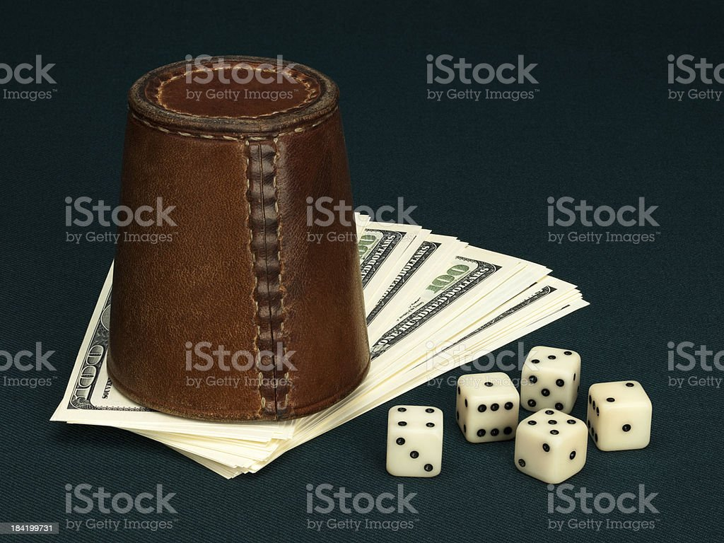 Dice, leather cup and dollars. royalty-free stock photo