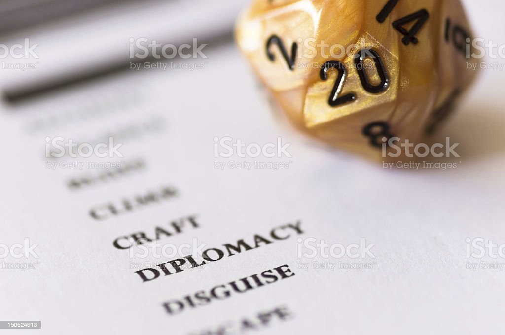 D20 Dice on Character Sheet Ability royalty-free stock photo