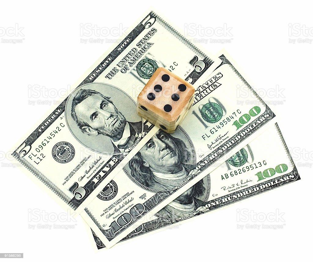 Dice on dollars stock photo