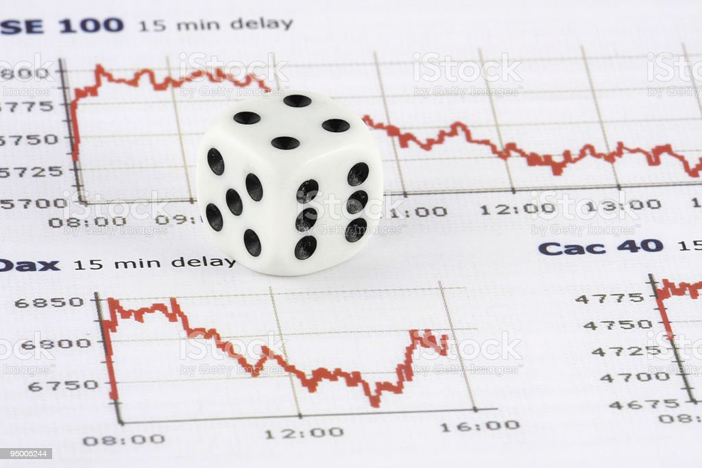 Dice on financial index chart royalty-free stock photo