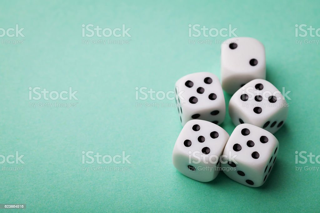 Dice on green background. Gambling devices. Casino concept. stock photo