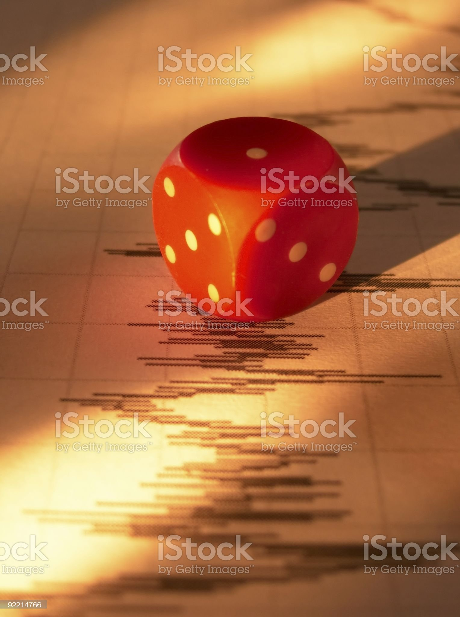 Dice on stock page royalty-free stock photo