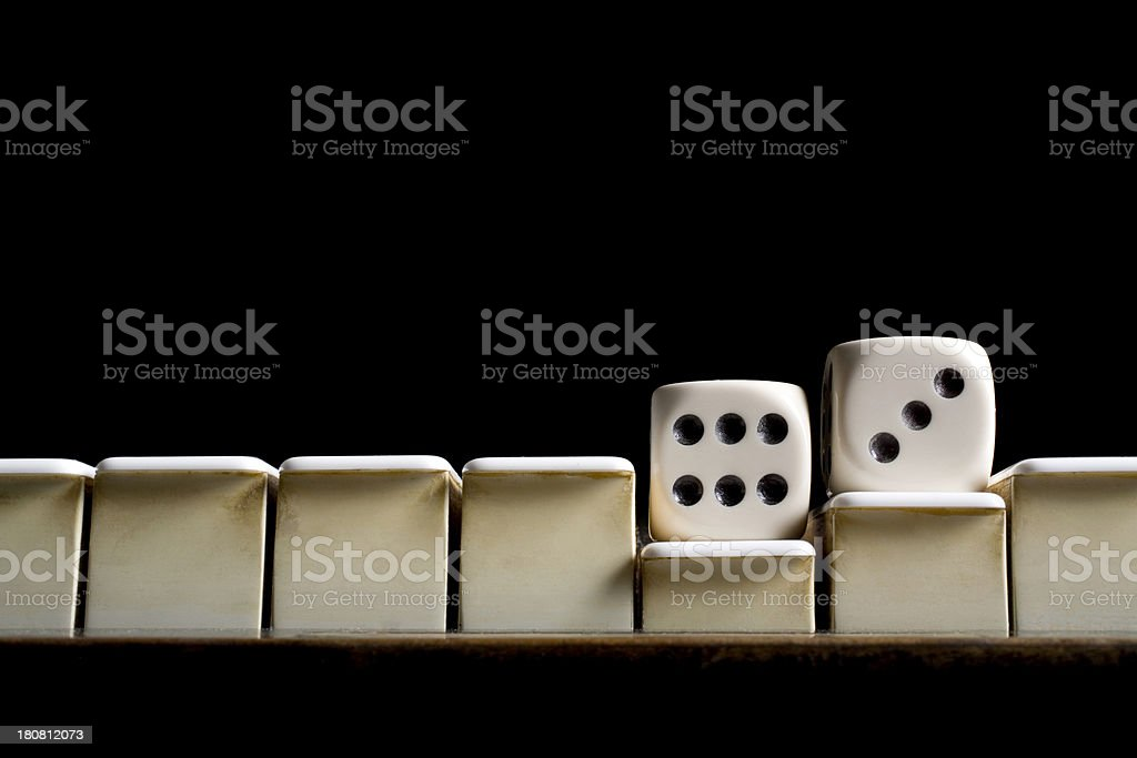Dice on the piano stock photo