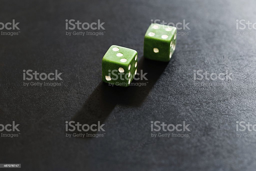 Dice show score of 7 on black background royalty-free stock photo