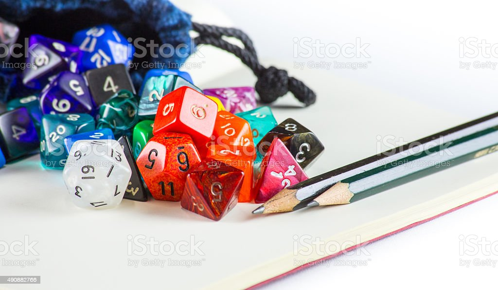 Dice spilling out of a Dice bag with Pencils stock photo