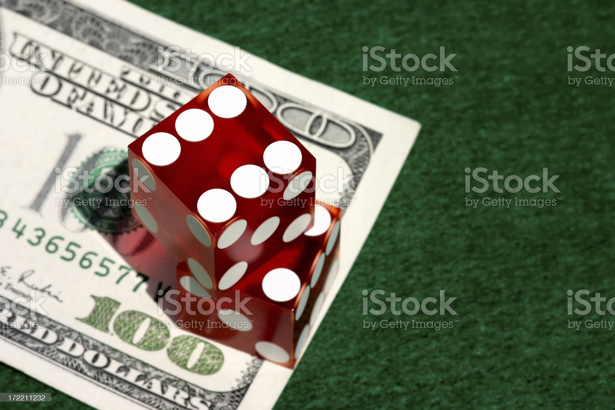 Dice stacked on $100 Bill royalty-free stock photo