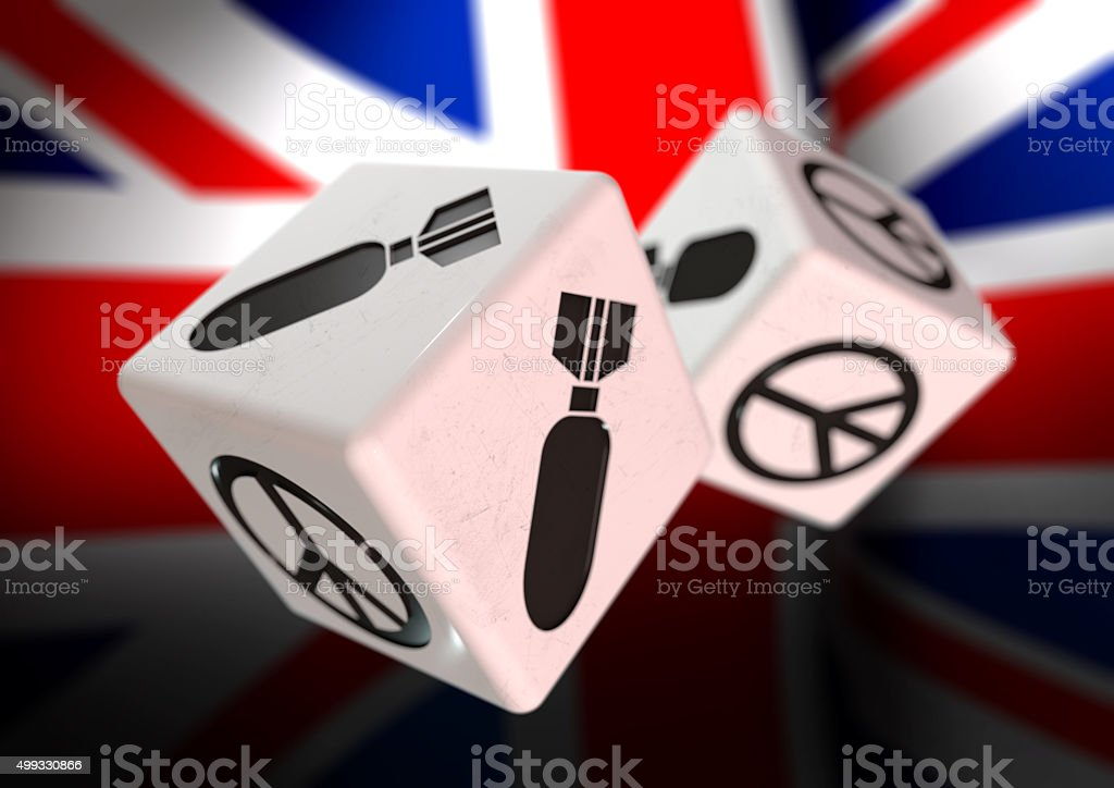 Dice with bomb and peace symbols on British flag background. stock photo