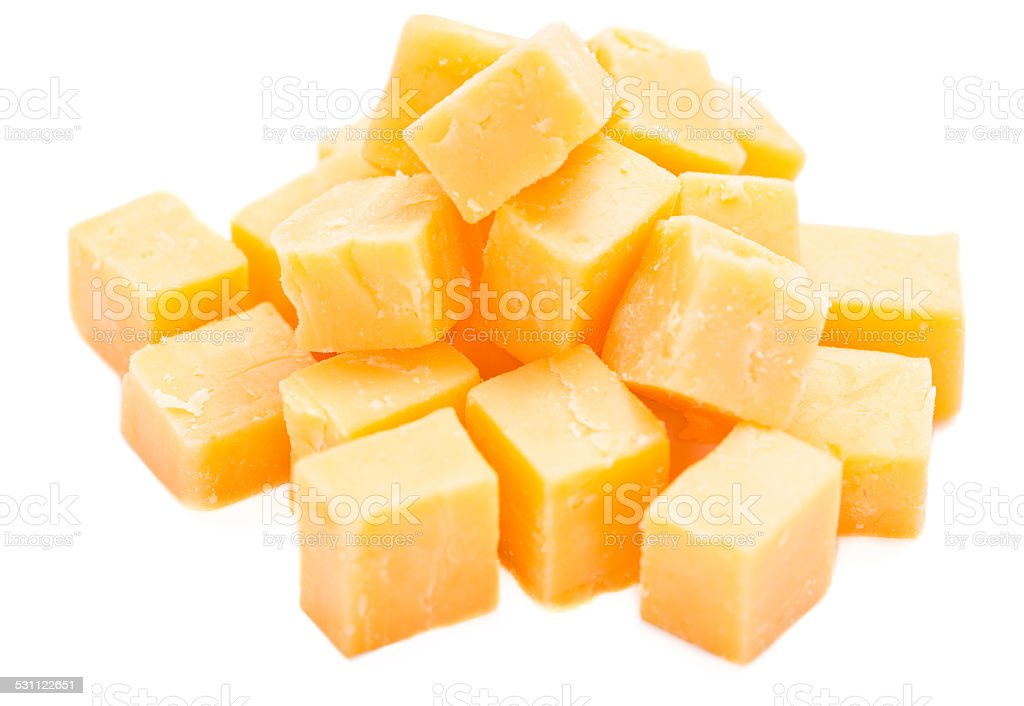 Diced Cheddar isolated on white stock photo