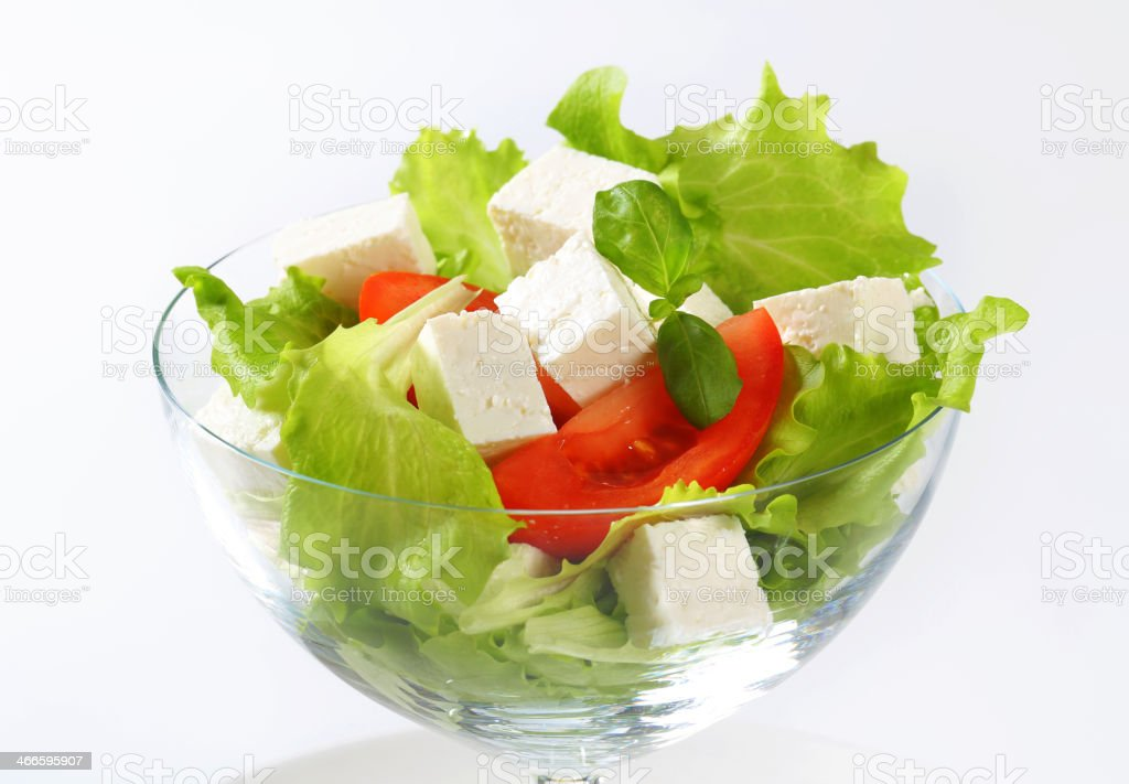 Diced feta with fresh vegetables stock photo