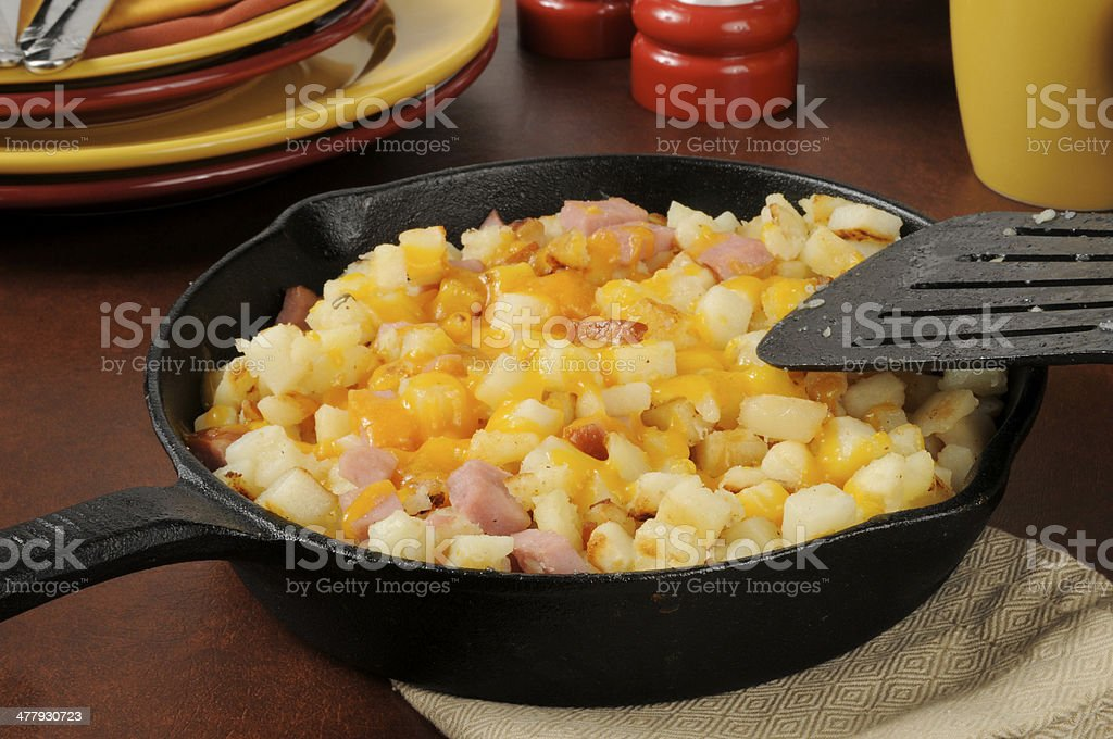 Diced ham and potatoes with cheddar cheese royalty-free stock photo