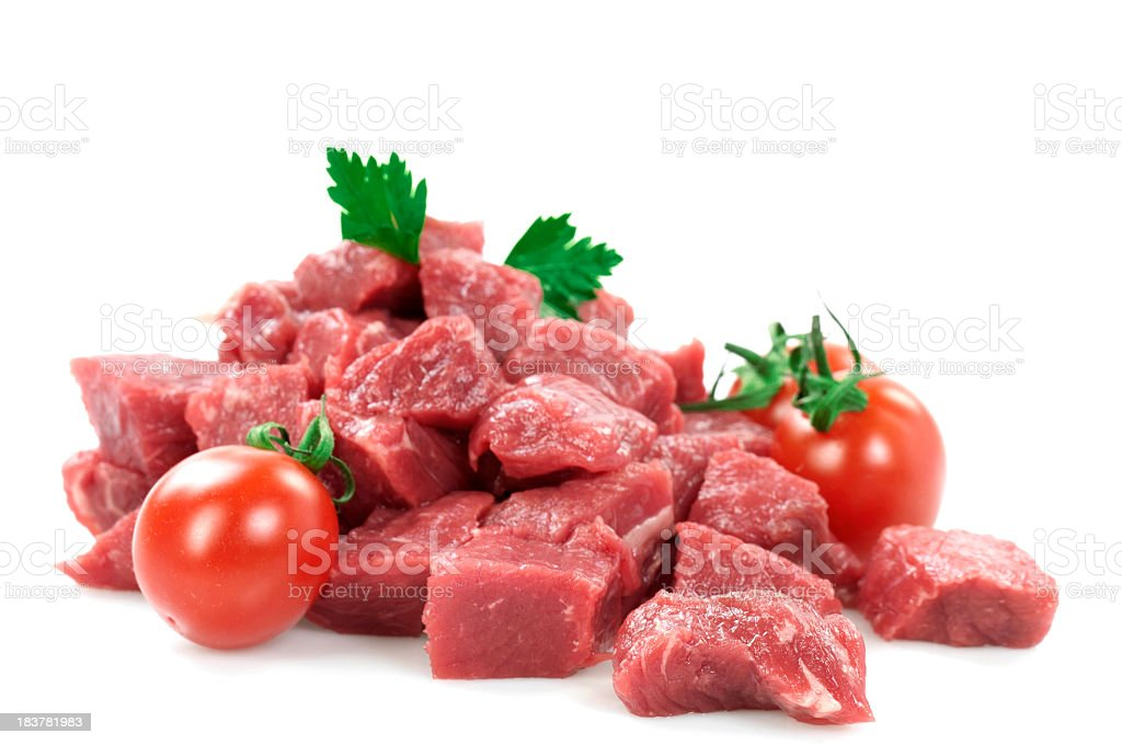Diced raw meat with fresh cherry tomatoes and parsley royalty-free stock photo
