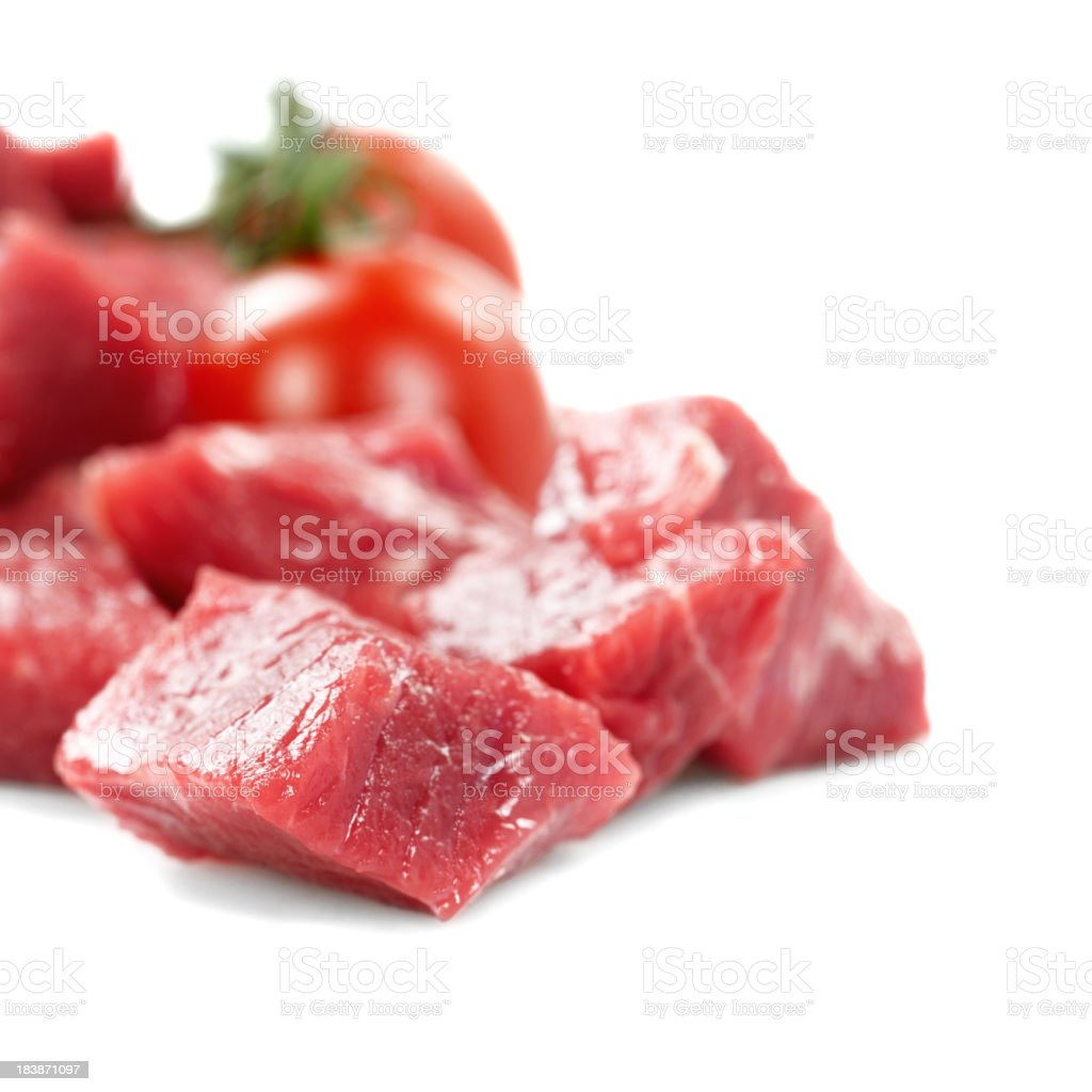 Diced Raw Meat With Plum Tomatoes royalty-free stock photo